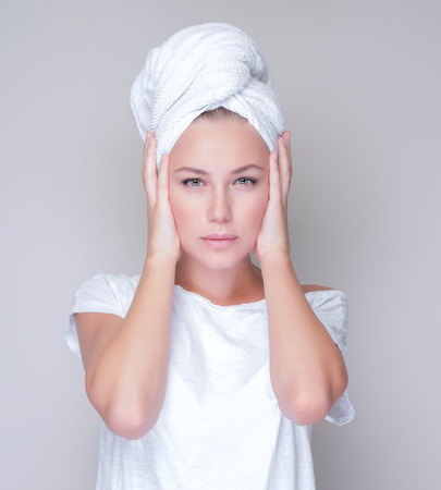 sensitive skin: Closeup portrait of beautiful young woman with towel on head isolated on gray background, enjoying day spa, beauty treatment concept