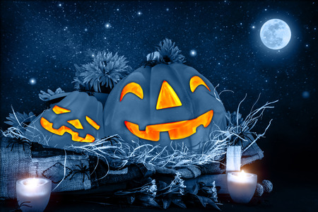 star of life: Halloween night, scary carved pumpkin head glowing in dark starry night, full moon, traditional october holiday, horror concept