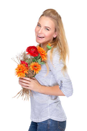 Happy woman with beautiful fresh autumn flowers isolated on white background, enjoying wonderful gift for Thanksgiving day photo