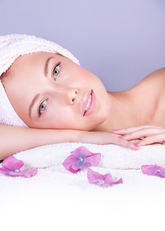 Closeup portrait of beautiful woman in spa salon, lying down on massage table, enjoying dayspa, luxury lifestyle, healthcare and body pampering concept
