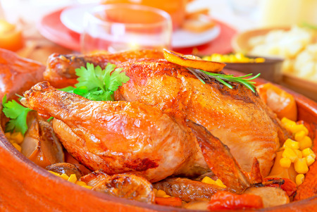Delicious Thanksgiving turkey on festive table, traditional prepared poultry for American autumn holiday, family dinner at home Stock Photo