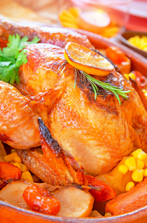 Delicious Thanksgiving turkey on festive table, traditional prepared poultry for American autumn holiday, family dinner at home photo