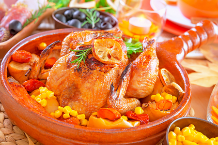 Closeup on delicious prepared Thanksgiving turkey baked with vegetables, traditional American autumn holiday, festive dinner at home concept photo
