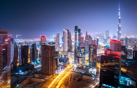 tourism: Beautiful night cityscape of Dubai, United Arab Emirates, modern futuristic arabian architecture with many little lights in the nighttime, luxury traveling concept Stock Photo