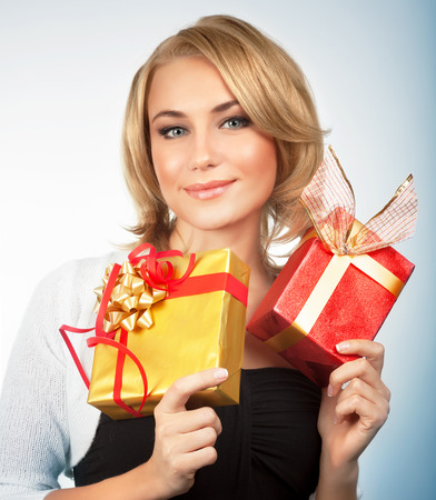 Portrait of pretty woman with two Christmas gift boxes isolated on white background, receive romantic presents on New Year holidays photo