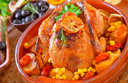 Closeup on delicious baked Thanksgiving turkey baked with vegetables, traditional American autumn holiday, festive dinner at home concept photo