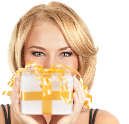 woman face close up: Closeup portrait of attractive female with little gift box in hands isolated on white background, Christmas holidays concept