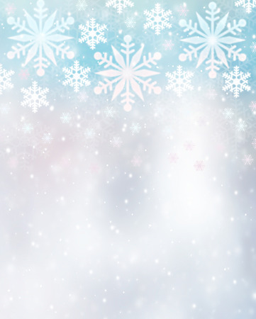 snowflake border: Beautiful snowflakes border on blurry background, cute Christmas greeting card with copy space, festive winter time decoration