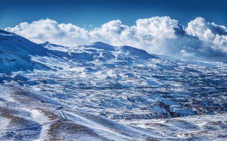 Beautiful winter mountains, majestic snowy landscape, luxury ski resort, Christmas greeting card, beauty of wintertime nature photo