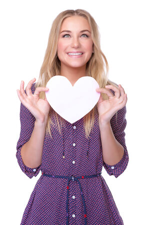 Portrait of cute happy romantic girl with paper heart isolated on white background, Valentine day celebration or cardiology treatment concept photo