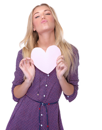 kissing lips: Portrait of pretty woman in love, sexy female with heart-shaped greeting card isolated on white background, air kiss, Valentine day celebrations