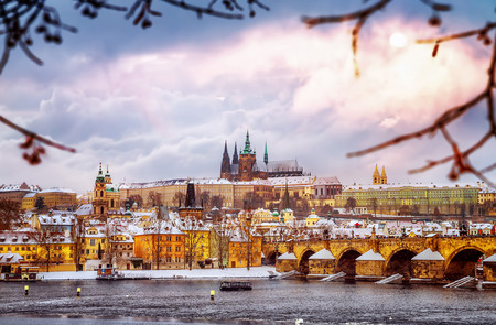 Beautiful Prague in winter, Charles bridge over Vltava river, Czech republic, historical  medieval buildings, wintertime European cityscape