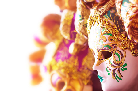 carnival border: Many beautiful Venetian masks decorated with gold, gorgeous art border, traditional carnival face accessory, luxury European vintage art