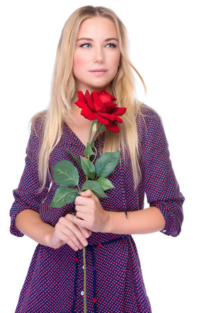 Portrait of attractive gentle woman with beautiful red rose isolated on white background, receive gorgeous flower on Valentine day photo