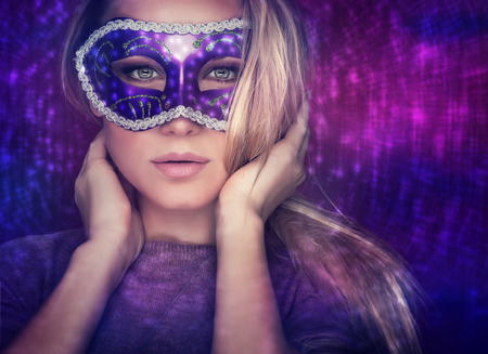 sexy halloween girl: Beautiful female wearing mask, mysterious girl with nice makeup at masquerade, stylish woman portrait studio shot over party light background, holiday celebration