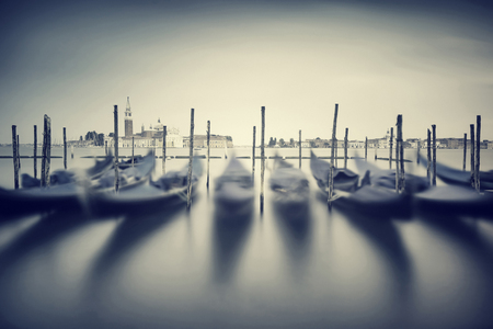 shallow focus: Vintage Venice cityscape , slow motion of beautiful traditional Venetian gandolas, grunge style photo, fine art photography