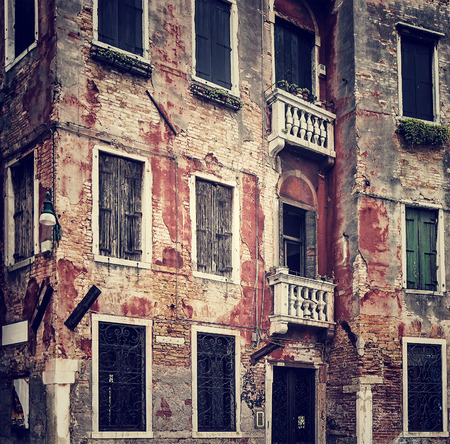 italian architecture: Abstract grungy old wall background, vintage building facade, traditional Italian architecture, venetian aged exterior, Venice, Italy Editorial