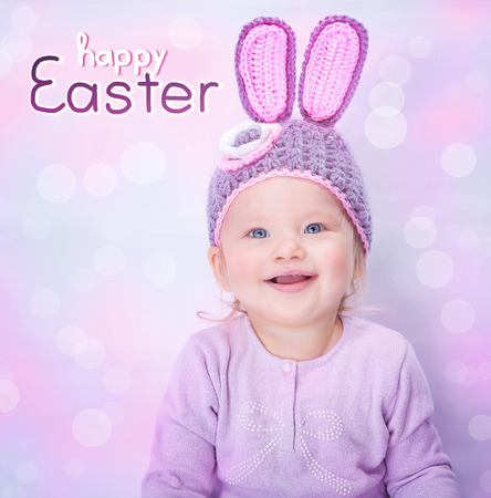 pink rabbit: Portrait of cute cheerful Easter bunny, little baby girl wearing pink rabbit ears isolated on blur background, happy spring holiday concept