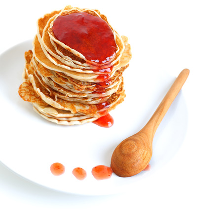 flapjacks: Big pile of tasty pancakes with sweet strawberry syrup on the plate isolated on white background, perfect food for morning meal
