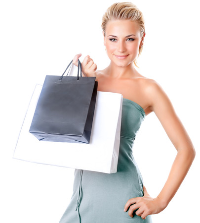 Beautiful female holding shopping bags, woman isolated on white background, girl buying presents and spending money, seasonal sales