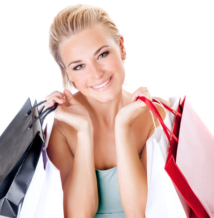 gift spending: Portrait of cute happy girl with shopping bags isolated on white background, enjoying seasons sales, spending money with pleasure Stock Photo