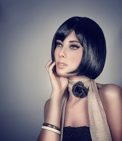 Portrait of sexy woman isolated on gray background, retro style fashion look, gorgeous hairdo and stylish makeup, luxury beauty salon photo