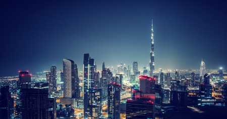 birds eye: Beautiful Dubai cityscape, birds eye view on a night urban scene, modern city panoramic landscape, United Arab Emirates