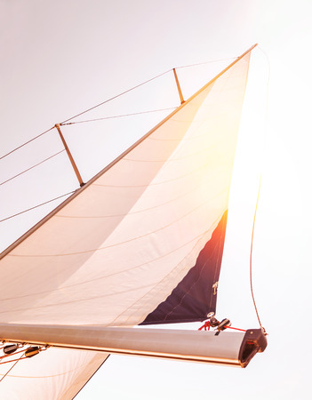 Sail over sunset sky, romantic date in warm summer evening on luxury sailboat, interesting sea adventure, travel and tourism concept photo