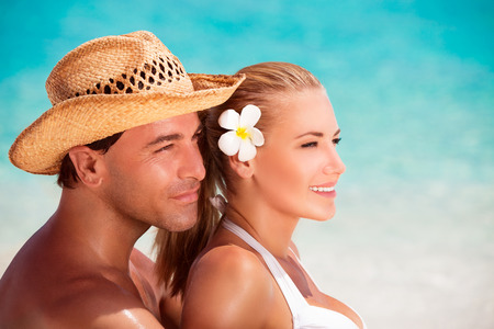 sexy couple embrace: Portrait of beautiful young couple on the beach, wearing cute beach accessories, affectionate gentle family in romantic summer vacation Stock Photo