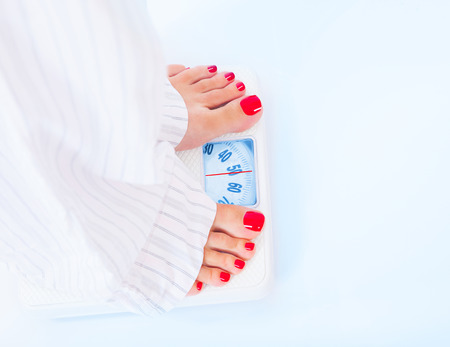kilogram: Woman barefoot standing on scales, 50 kilogram, body part, healthy lifestyle and nutrition, result of diet and fitness, weight loss concept