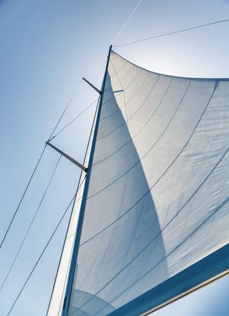 空を背景に帆します。 写真素材