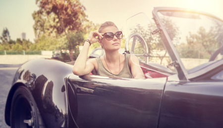 Beautiful woman sitting in cabriolet Stok Fotoğraf - 39929283
