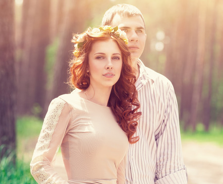 relationship love: Portrait of beautiful dreamy couple in the forest in bright sunny day, wedding celebration, romantic relationship, love and fashion concept Stock Photo