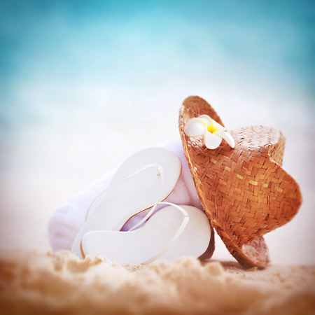 beachwear: Summer holidays background, beautiful beach items on sandy coast, vacation border with copy space, traditional beachwear, relaxation concept