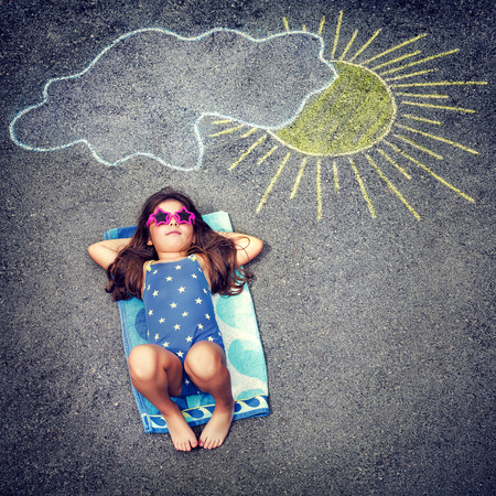 child swimsuit: Cute little baby girl having fun outdoors, drawing on asphalt sun and tanning under it, happy childhood in summer camp, active summertime holidays