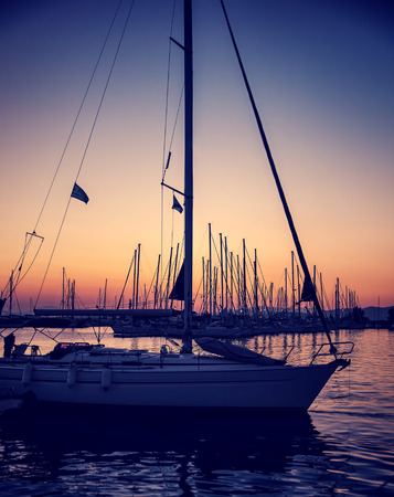 wonderful: Beautiful sailboat on sunset, yachts harbor in the Greece, wonderful place for summer adventure, luxury water sport