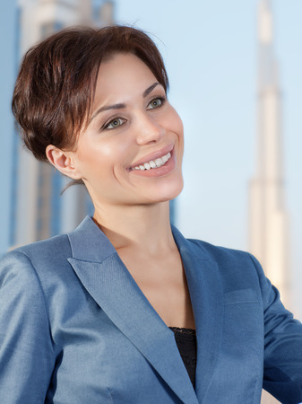 vp: Portrait of beautiful smart business woman in the office on luxury buildings background, working in great successful company Stock Photo