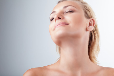 pleasure: Satisfied woman at spa, portrait of beautiful female with closed eyes of pleasure over light background, natural cosmetics, enjoying day at spa salon