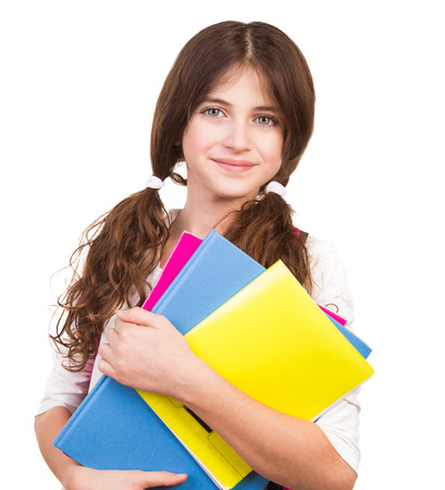 Portrait of cute brunette schoolgirl holding in hands three colorful notebooks, isolated on white background, back to school concept Stockfoto