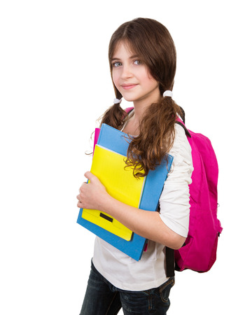 Portrait of cute schoolgirl with bag and books in hands isolated on white background, back to school, start of educational season Foto de archivo