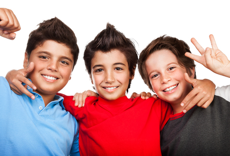 three persons: Portrait of cute happy three boys isolated on white background, cheerful teenagers, best friends hugging in the studio