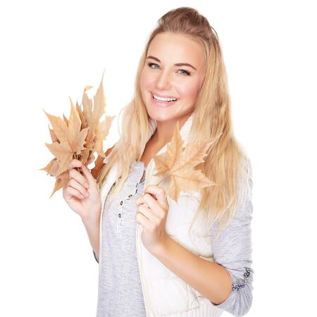 fall leaf: Portrait of beautiful blond woman with dry leaves bouquet isolated on white background, enjoying autumn season