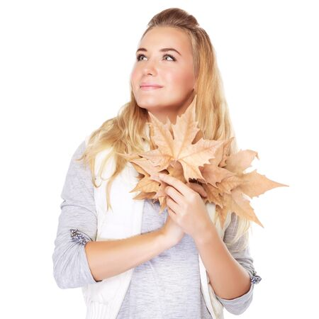 fall leaf: Portrait of cute dreamy girl with dry leaves bouquet in hands looking on a side, isolated on white background, autumn season
