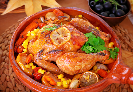 centerpiece: Closeup photo of tasty baked turkey in centerpiece of festive table, traditional food for Thanksgiving day holiday Stock Photo