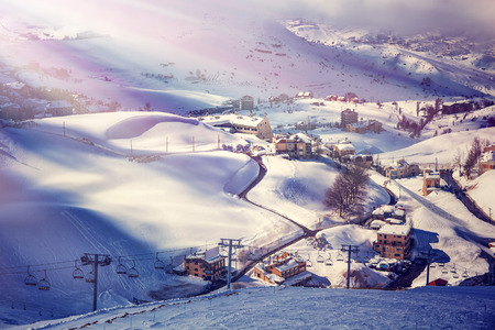 chalets: Air view on beautiful ski resort, mountain covered with snow, luxury little cottages and chalets, spending winter holidays in Lebanon