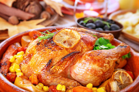 holiday food: Closeup photo of tasty baked turkey in centerpiece of festive table, traditional food for Thanksgiving day holiday Stock Photo