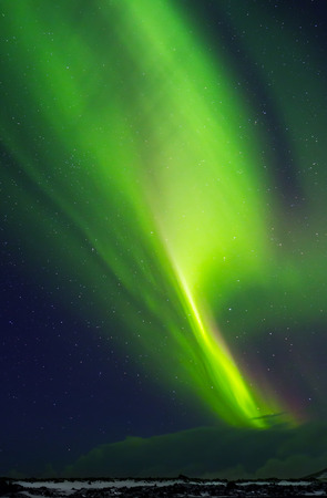 northern light: Beautiful green Northern light in the starry sky, natural phenomenon, Aurora Australis, wonderful nature of Iceland