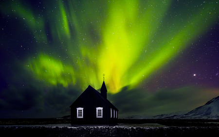 iceland: Beautiful bright green Northern light over church, little village in the Iceland, amazing forces of nature, wonderful night sky landscape