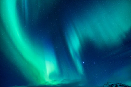 Beautiful blue and green Northern light, abstract natural background, magic paranormal light in the night starry sky, beautiful nature of Iceland 스톡 콘텐츠