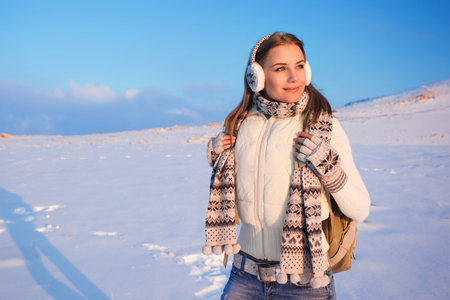 snowy mountains: Portrait of cute happy female spending winter holidays in the mountains, enjoying beautiful snowy view, healthy active lifestyle